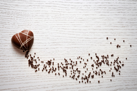 Heart shaped chocolate on white background Standard-Bild - 73214913