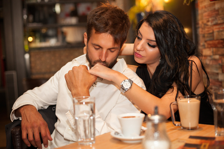 Boyfriend kiss hand of his girlfriend gently with his eyes closed Stock Photo