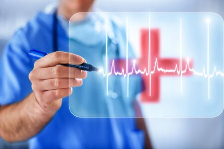 Doctor drawing heart pulse on transparent white background with red cross