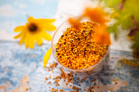 Close shot of bee pollen in plastic glass on the table