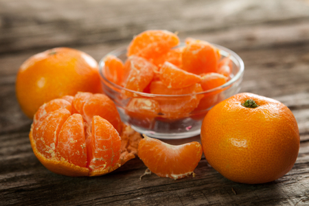 clementines: Tasty sweet peeled and unpeeled clementines
