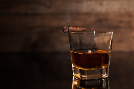 Cigar and glass with whiskey