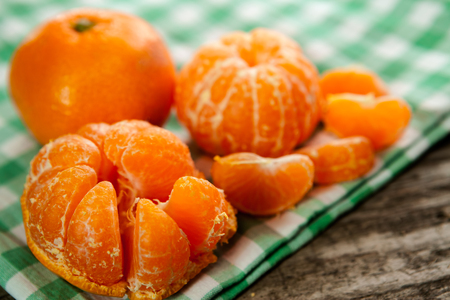clementines: Peeled fresh clementines on kitchen cloth