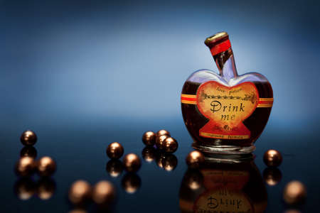 pocima: Heart shaped bottle with romantic potion with heart shaped liquid