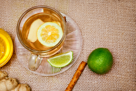 Ginger tea with lemon and lime on the table