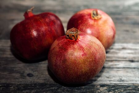 Juicy red pomegranate on wooden table Stock Photo