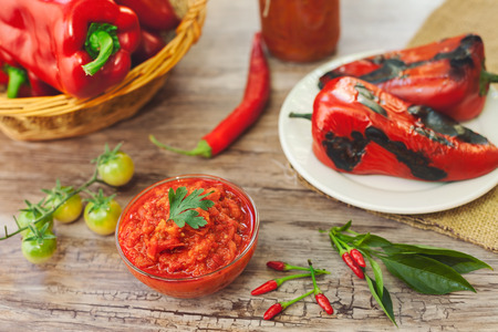 Baked red peppers and Ajvar on the table Stock Photo - 88836508