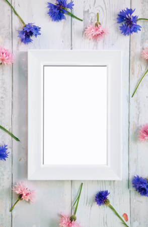 Empty picture frame with flowers around the frame
