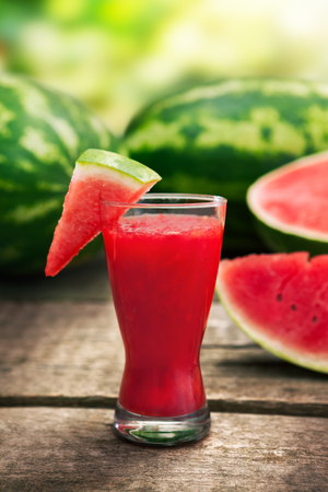 Fresh watermelon juice in glass with watermelon slice