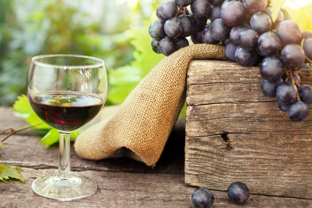 Fresh grapes and glass of red wine