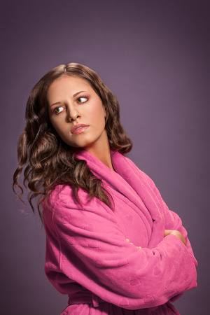 Beautiful brunette woman in pink bathrobe Standard-Bild