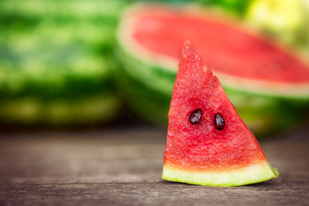 Watermelon slice on wooden table Standard-Bild