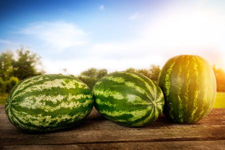 Sweet watermelons on wooden table Standard-Bild
