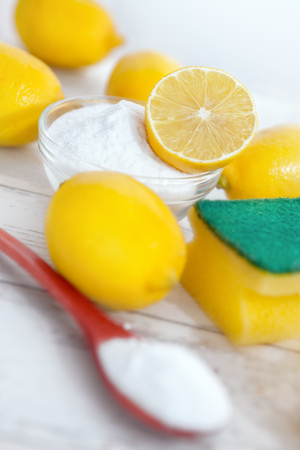 Eco-friendly natural cleaners for effective house cleaning, baking soda and lemon Stock Photo