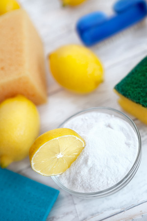 Baking soda and lemon, household cleaners with sponges and cleaning brush