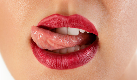 Sexy red licking lips, beautiful lip, lipstick and lipgloss, passionate. Tongue and mouth
