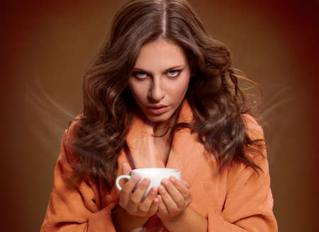 Young woman holding cup with coffee or tea Archivio Fotografico
