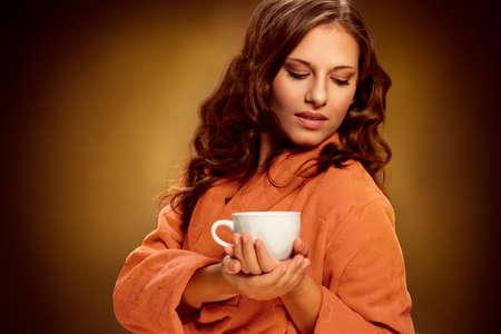 Beautiful woman with coffee mug posing Archivio Fotografico