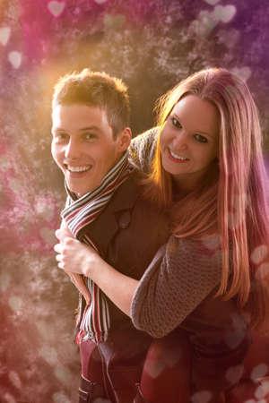 Happy young woman enjoying a piggyback on boyfriends back Archivio Fotografico