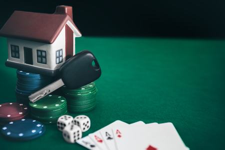 Poker game with high stakes on poker table. Poker addiction. Stock Photo