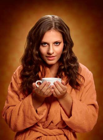 Coffee mug. Young woman holding coffee mug.