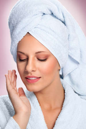 Spa woman with towel on head in salon Archivio Fotografico