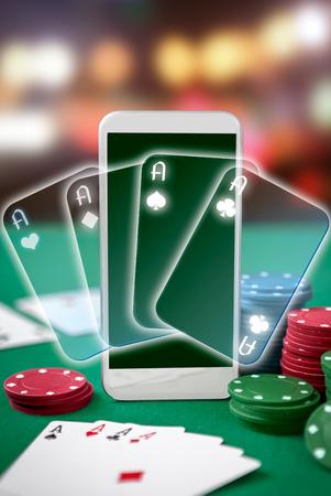 four aces on smartphone screen. Online gambling. Winning poker hand