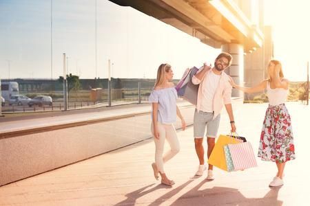 Happy friends shopping, young friends enjoying in shopping Standard-Bild - 103275643