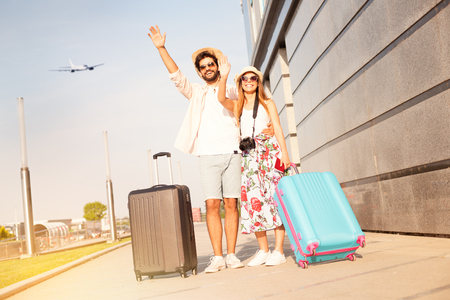 Love couple at the airport says goodbye to a friends and going to vacation, holiday, honeymoon, adventure… Standard-Bild - 103275727