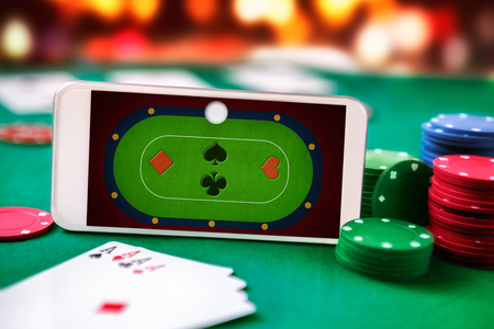 Smartphone with online poker table application on screen. Online poker gaming and gambling.