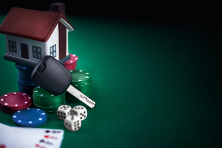 Poker game. Poker addiction. Poker stake. House and car keys on card chips. Standard-Bild - 103275793