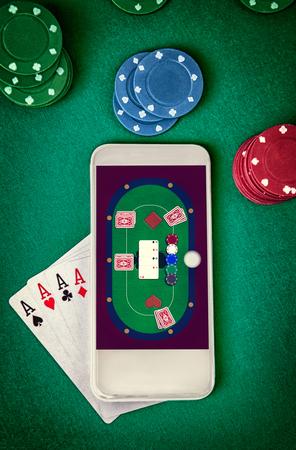 Online casino.Mobile casino. Smartphone with poker table on screen. Standard-Bild - 103275797