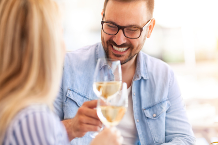 young man smiling and toasting with her girlfriend, happy day Standard-Bild
