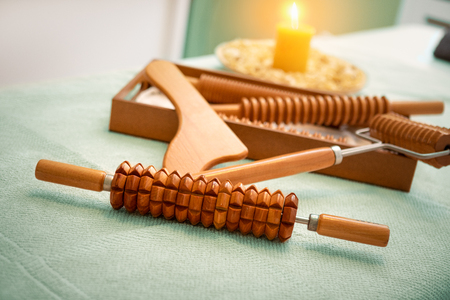 On the massage table is a tool for ant cellulite massage of Madero therapy.