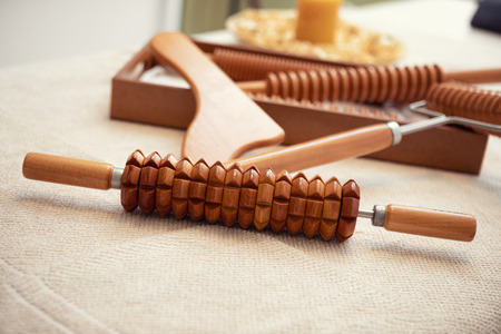 Props for body anti cellulite massage, wooden rolling pin