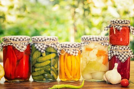 Organic canned vegetables in glass jar. Homemade canned vegetables.