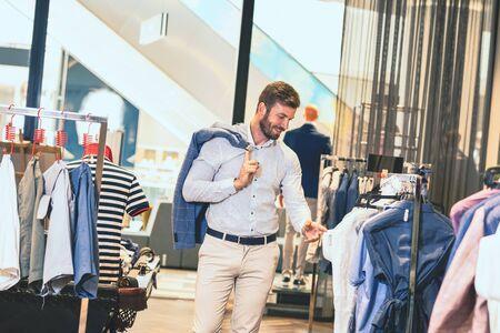 Man browsing shirt in clothing store