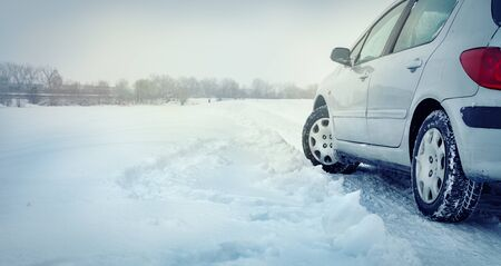 Winter tire - tyre in the snow. Dangerous driving conditions. Driving safely in the winter