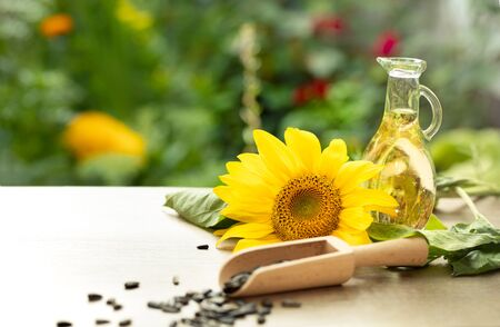 Dressing of organic sunflower oil in glass bottle with sunflower and seeds