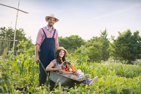 Nice couple farmer having fun in vegetable garden