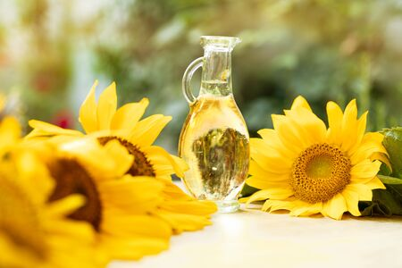 bottle glass with sunflower oil with seed