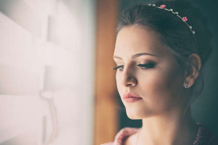 Tender portrait of a girl with elegant bridal hairstyle