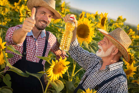 Young farmer with his father approves the quality of their product