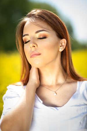 Portrait of pretty woman  with close eyes enjoy in sun