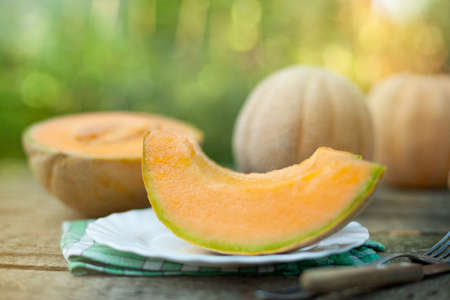 Pieces of ripe melon. On a wooden table.