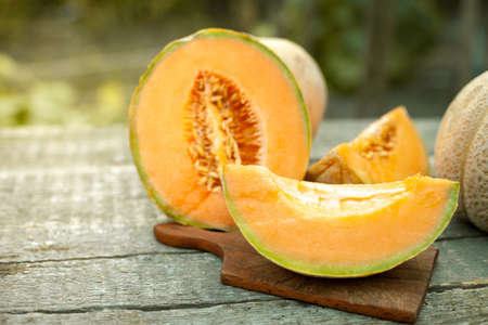 Tasty cut melon on rustic wooden table