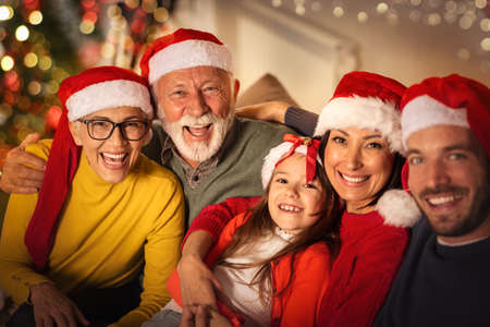 Portrait of happy Christmas family with Christmas hats