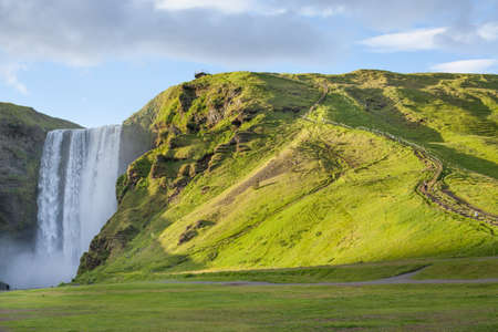 skogafoss waterfall: The Skogafoss waterfall in the south of Iceland at the cliffs of the former coastline Stock Photo