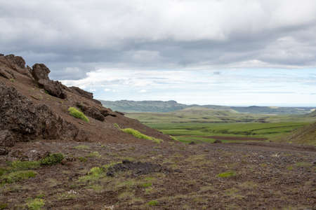 a beautiful mountain in Iceland, covered with grass