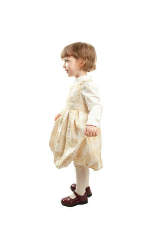 Full length portrait of a happy little girl in elegant dress, isolated on white background